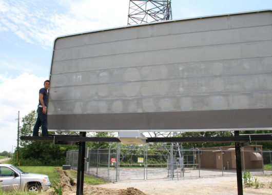 Justin proudly posing with our first billboard